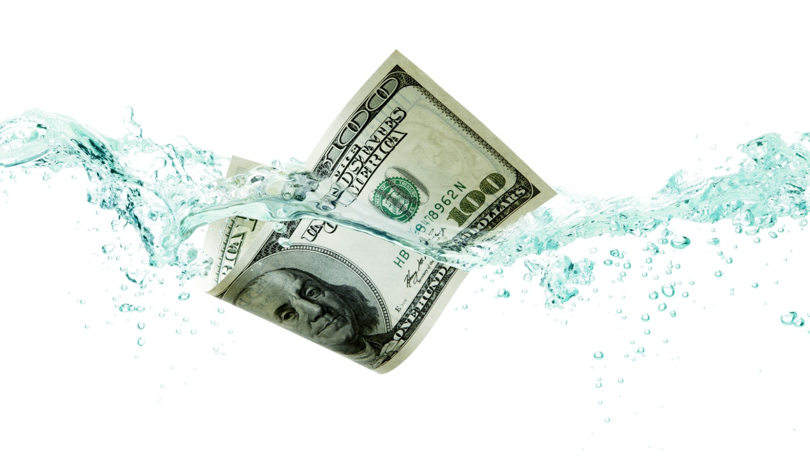 Money Dropping into Water
